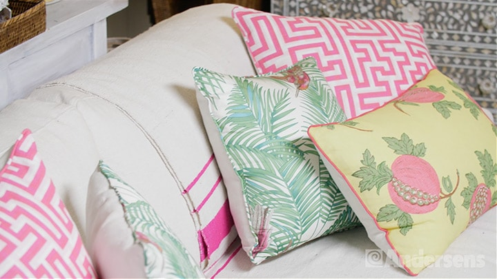 Brightly coloured cushions in an assortment of patterns