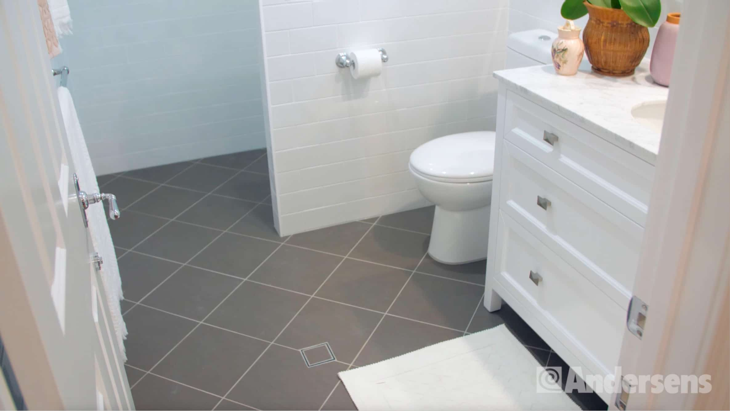 Grey tiled ensuite bathroom floor