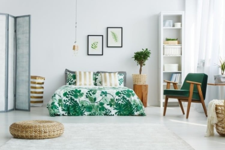 Airy bedroom with lush green decor