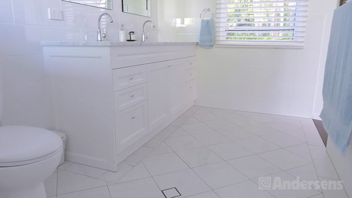 White joinery in the bathroom with crystal drawer knobs