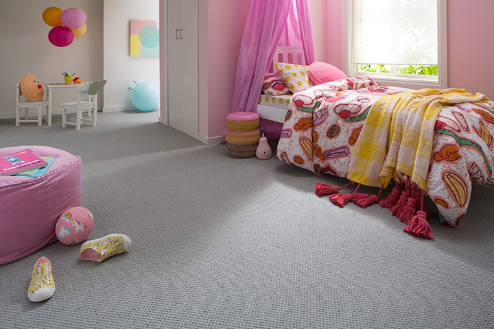 Girl's bedroom with plush pouf seating
