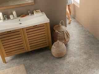 Bathroom with stone textured vinyl floor