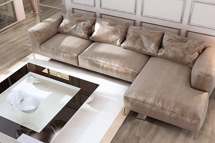 Classic formal lounge room in neutral colours with a plush sofa suite