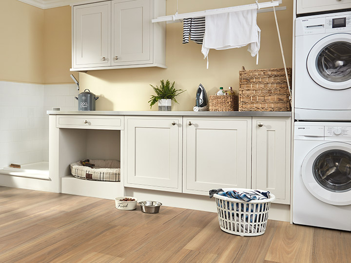 Laundry room with washer and dryer and alcove for pet bed