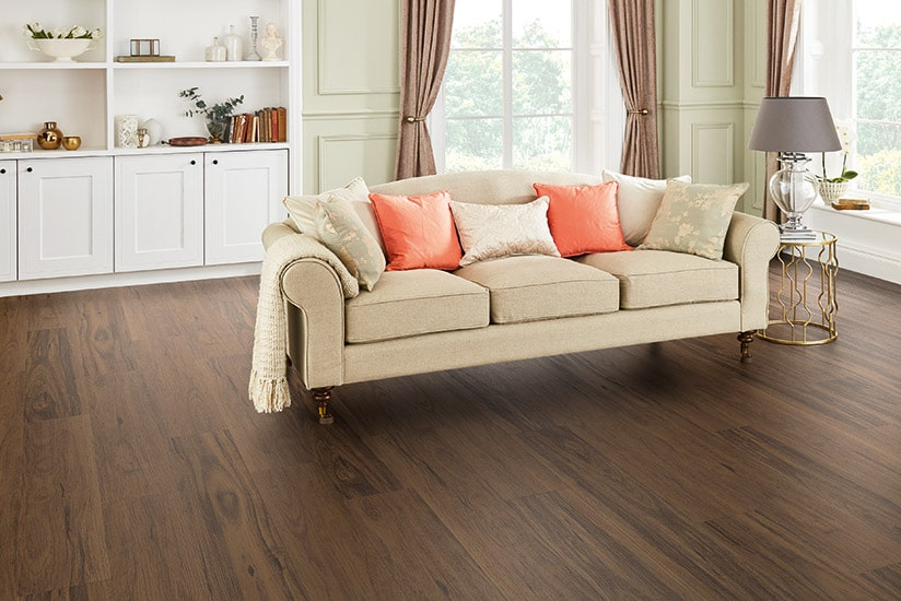 Formal lounge room with rich brown timber-look vinyl plank flooring