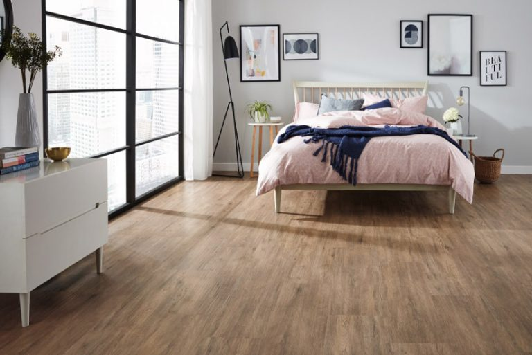 Loose lay vinyl plank flooring installed in a contemporary apartment bedroom