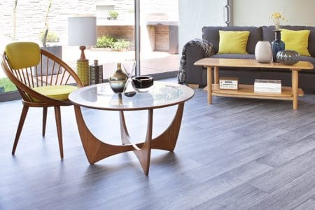 Yellow and wood lounge setting set on neutral grey timber-look flooring.