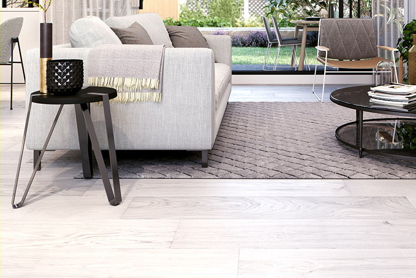 Living room with white timber-look vinyl flooring furnished with modern furniture